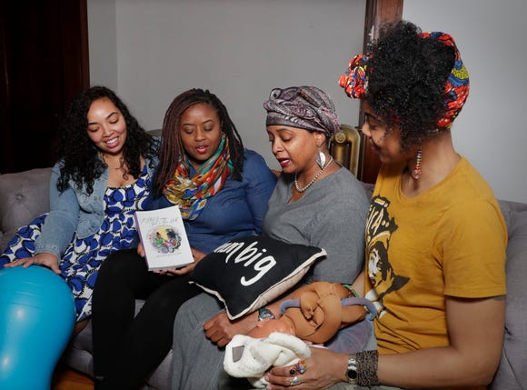 Shani Toor (left), Kisha Shanks, Tiffany Scaife and Vanessa Johnson meet often as a community of doula sisters to encourage one another and share information.