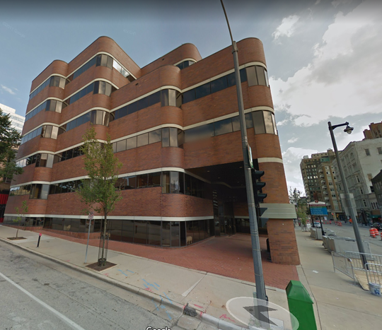 A downtown Milwaukee office building has been sold and is being converted into a co-working site.