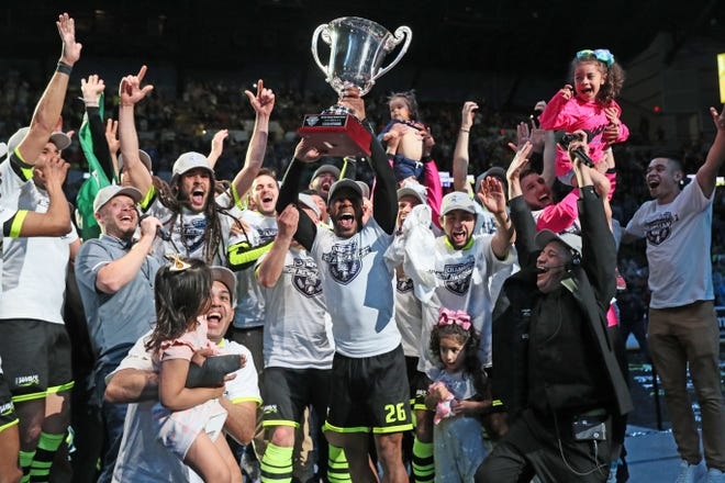 Milwaukee Wave players with the Ron Newman Cup  after winning the 2018-19 MASL championship.