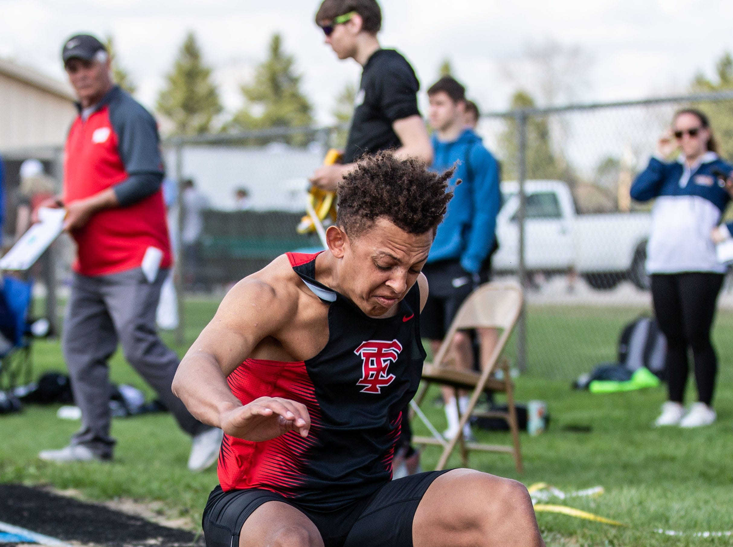 Wauwatosa East senior Jaxon Holley competes in the long jump at the 2019 Myrhum Invitational track and field meet in Hartland on Saturday, May 4.