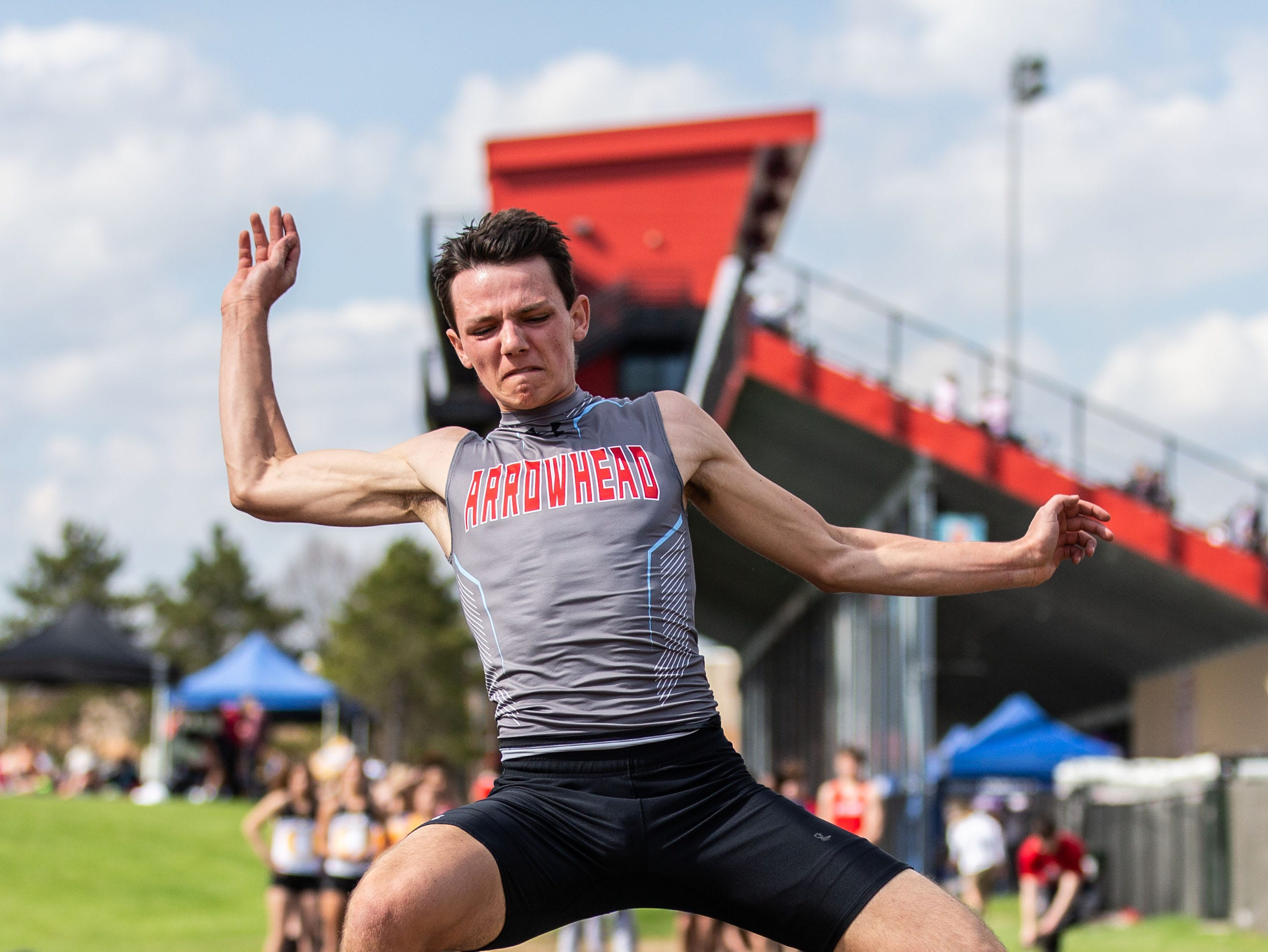 Arrowhead jumior Zachary Tarnowski competes in the long jump at the 2019 Myrhum Invitational track and field meet in Hartland on Saturday, May 4.