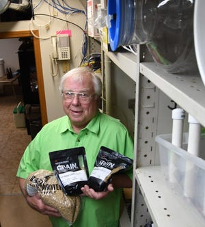 Bob Bainbridge holds three  different types of barley grains while standing in the beer-brewing area of his Promise Land home Saturday. The Twin Lakes Home Brewers will hold a public demonstration of their hobby this Saturday at Rapp's Barren in Mountain Home.