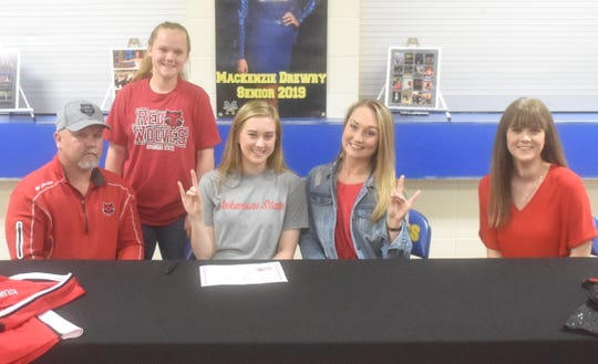 Mountain Home's Mackenzie Drewry (middle) signed Monday to attend Arkansas State University in Jonesboro as a member of the Red Wolves dance team. Pictured with Drewry are: (from left) her father David Drewry, sister Mallorie Drewry, Arkansas State spirit programs coach Paige Pauley, and mother Jennifer Drewry, who is also the MHHS dance coach.