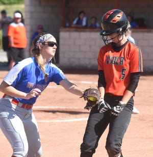 Viola's Carly Sanders is back at third base before the tag by Hillcrest's Maddy Brown on Sunday night.