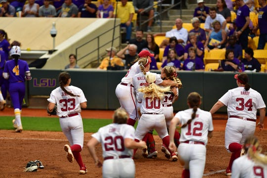Alabama players celebrate after securing the program's first regular-season Southeastern Conference championship since 2012 with a 4-3 win over LSU on May 4, 2019 at Tiger Park in Baton Rouge, Louisiana. (Photo provided by Alabama athletics)