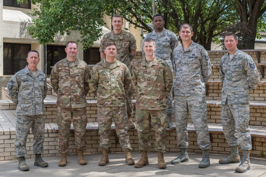 Staff members from the Airey Noncommissioned Officer Academy pose for a group photo, April 23, 2019, outside their new building here. After losing their learning environment on Tyndall Air Force Base during Hurricane Michael, a small group of Airey NCOA instructors made the trip to Maxwell in order to continue the education of Air Force Noncommissioned Officers.