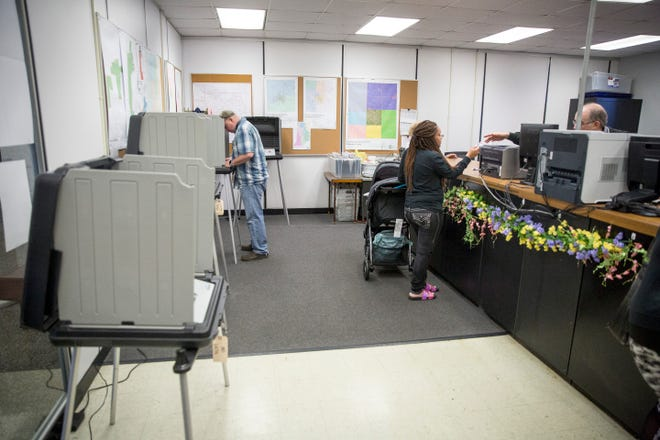 A few last minute voters sign in and cast their ballot during the final day of early voting on May 6 at the Delaware County government building. According to officials over 1,400 ballots were cast during the early voting period.