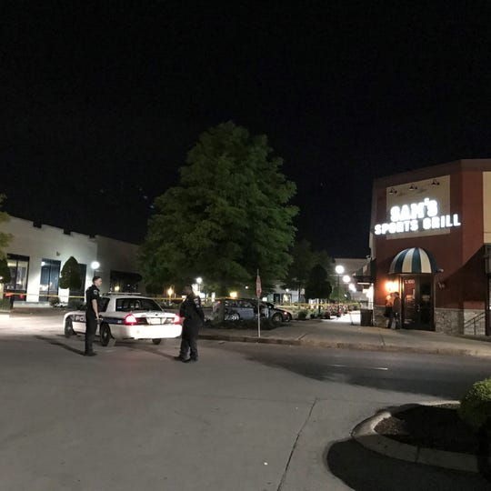 In this May 6, 2019 photo, Murfreesboro police respond to a shooting at Sam's Sports Grill.