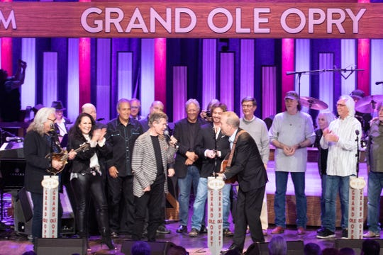 Randy Travis celebrated his 60th birthday Saturday night alongside Ricky Skaggs, songwriter Don Schlitz and more on stage at the Grand Ole Opry.