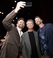 Charles Esten snaps a selfie with Randy Travis and Josh Turner during Travis' birthday celebration at the Grand Ole Opry.