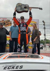Christian Eckes shows off the guitar trophy he won after claiming the Music City 200 ARCA Series race at the Fairgrounds Speedway Nashville.