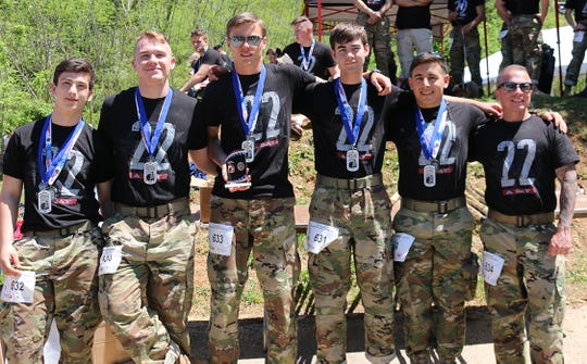 This is the winning team (completed the race in 2 hours 42 minutes) at the 2019 Mountain Man Memorial March April 27, 2019, wearing their first place medals.  Fairview High JROTC cadets Team 1 (l-r) Josh Klein, Will Jones, Ryan Keaton, Brandon Perkerson, Mario Pukl and 1SGT Christopher Turk.