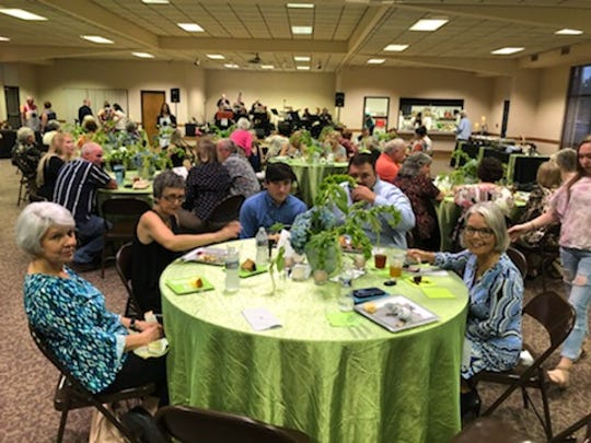 A table at last year's successful Jazz at the Park event benefiting the Humane Society of Dickson County.
