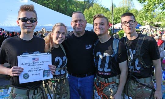 Fairview High's JROTC Light Team (l-r) Ryan Kelaher, Alyssa Ward, Mr. Moore (father of Cody J. Moore who was killed in action in 2010), Luke West, and Ryan Clinard. Light Team marched for Mr. Moore's son, and he greeted them at the finish line when they completed the race.  2019 Mountain Man Memorial March April 27, 2019.