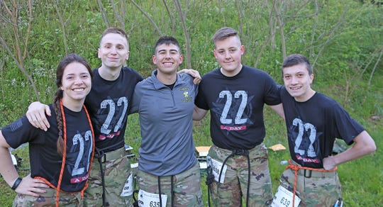 """Fairview High's JROTC Team 3 (l - r) Sarah Scarborough, Cody Turcotte, Blair Kocher, Bishop Goode, and James Wilson; finished the """"heavy"""" half-marathon in three hours and 54 minutes and earned third place in their competition class."""