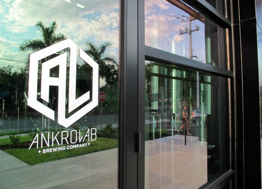 Fermentation tanks can be seen through the front windows of Ankrolab Brewing Co., which launched Friday, May 3, 2019, at 3555 Bayshore Drive in East Naples.