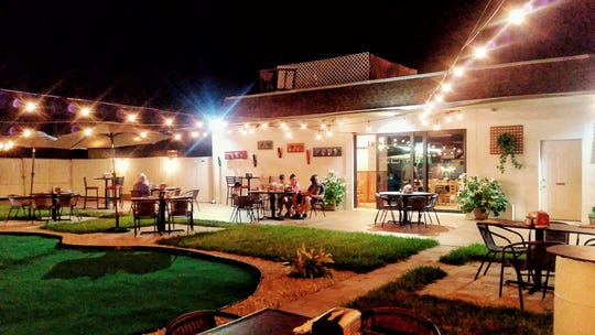 The outdoor patio includes a putting green at the new Sicilia on Bayshore Drive in East Naples.