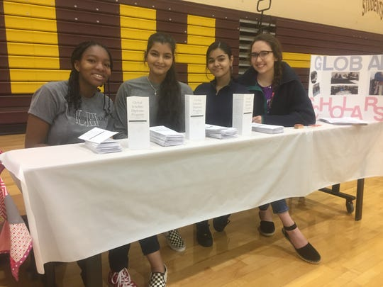 Randi Bradley, Anjana Poudyel, Bipana Basnet and Christina Mickelson were promoting the Global Scholars Diploma Program.