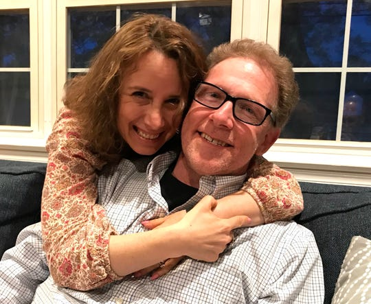 Jonathan Breuer, left, with his wife Sari in their home in Fair Lawn.