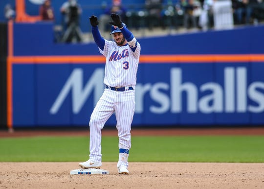 New York Mets pinch hitter Tomas Nido (3) celebrates after hitting a two run double in the eighth inning against the Milwaukee Brewers at Citi Field in New York on April 28, 2019.