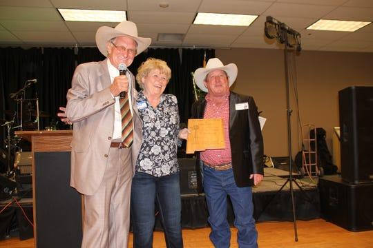 Old Timers President Leroy Zachek presents a commemorative plaque to past presidents Linda and Bobby Smrkovsky.