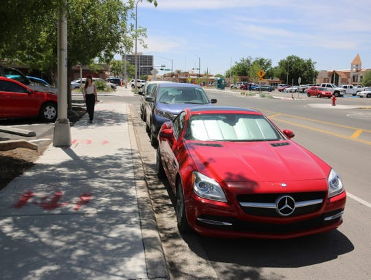 Vehicles sit parked on Water Street in the downtown Las Cruces on Monday, May 6, 2019.