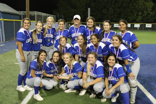 The Carlsbad Cavegirls pose after claiming the Class 5-4A district title on Friday. Carlsbad hosts Alamogordo in the first round of the state tournament this Friday at Carlsbad High.