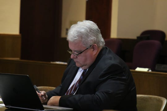 Fifth Judicial Assistant District Attorney Robert Perozynski mulls over some material during a change of plea hearing for Bobby Smith May 6 in Carlsbad.