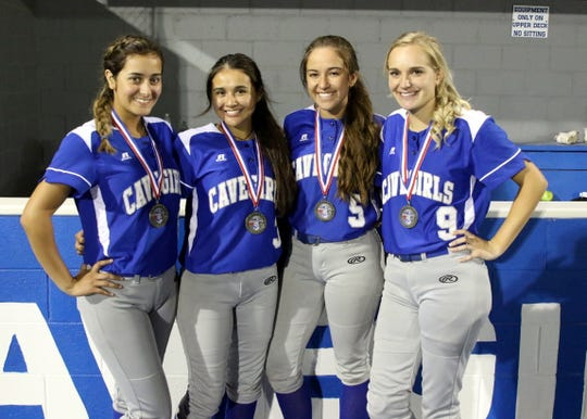 Left to right the senior members of the 2019 Cavegirl softball team: MJ Martinez, Marissa Reyes, Gabby Aragon and Jennifer Munro pose after claiming the Class 5-4A softball title against Hobbs.  This quartet is responsible for about 40 percent of Carlsbad's hits, runs and RBIs scored in the regular season.