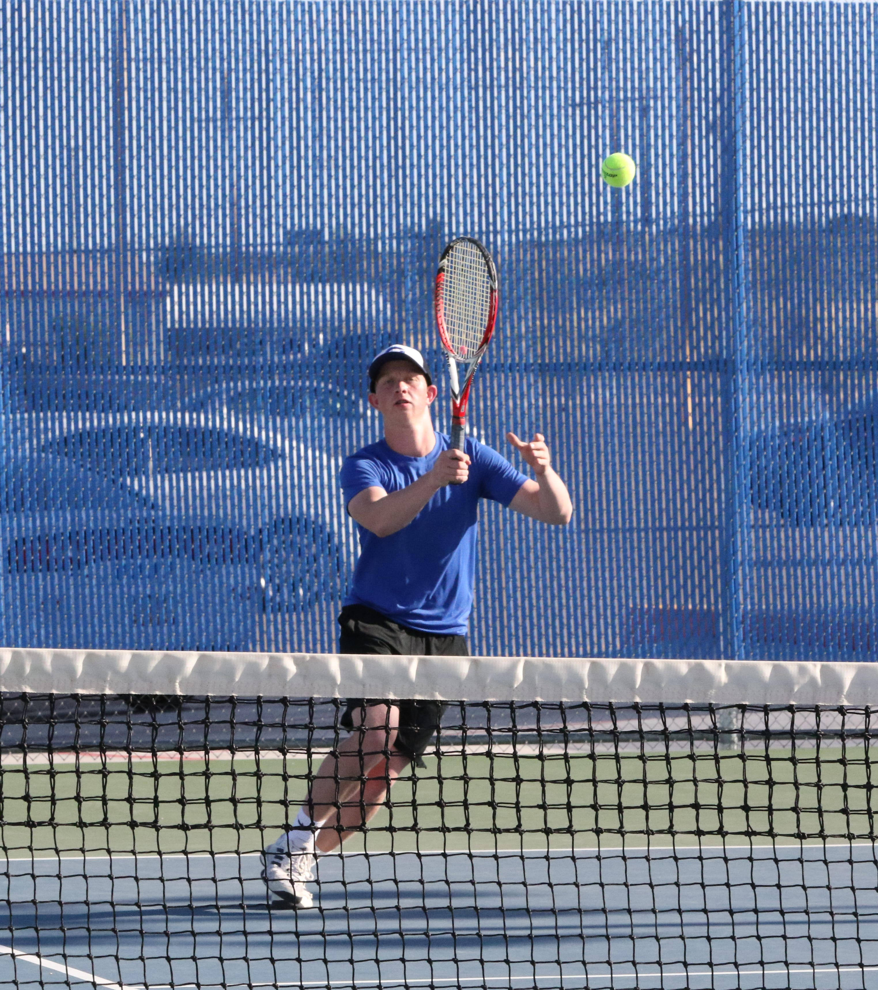 Carlsbad's Andrew Miller returns a serve during Friday's Class 5-4A district championship doubles tournament. Carlsbad will send nine tennis players to state this weekend.