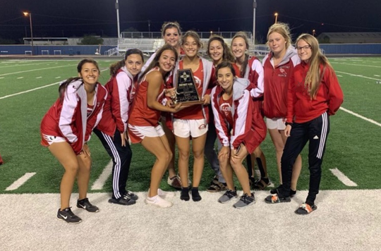 The Loving Lady Falcons pose with their district trophy on Friday in Jal.