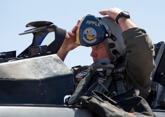 Maj. Jon Farragher, 311th Fighter Squadron assistant director of operations, dons his helmet before flying a familiarization flight for Airman 1st Class Mequail Fridge, April 25, on Hill Air Force Base, Utah. The goal of a FAM flight is to educate ground personnel about their impact on the mission.