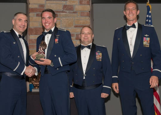 Col. Joseph Campo, 49th Wing commander, presents 1st Lt. Scott Lafferty, 8th FS F-16 Basic Course graduate, with an award, May 4, 2019, at Club Holloman on Holloman Air Force Base, N.M. Eight Viper pilot students graduated from the 8th FS first F-16 B-Course, nearly eighty years since the squadron's induction on Nov. 20, 1940.