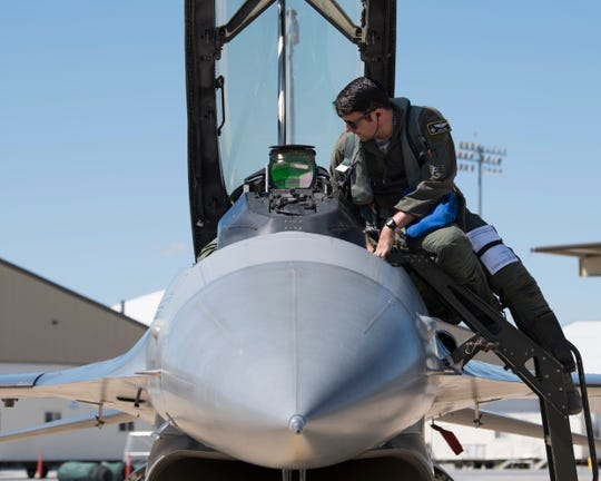 Maj. David Abel, 311th Fighter Squadron instructor pilot, exits his assigned F-16 Viper after a familiarization flight, May 2, 2019, on Hill Air Force Base, Utah. The 311th FS deployed to Hill for exercise Venom 19-01, April 22 - May 3, to perform dissimilar air combat training with the F-35 Lightning II.