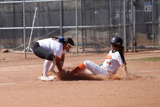 Aztec's Jocelyn Ulrich slides in safe at third base for a three-run triple against Shiprock's Meah Begay during a District 1-4A game on Thursday, April 18 at the Aztec Tiger Sports Complex. Aztec is the No. 3 seed in this year's 4A playoffs.
