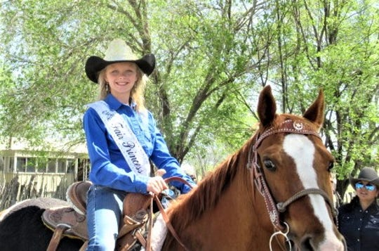 The Fair Princess  showed that she deserved the title as she rode in the Smokey Bear Days parade Saturday in Capitan.