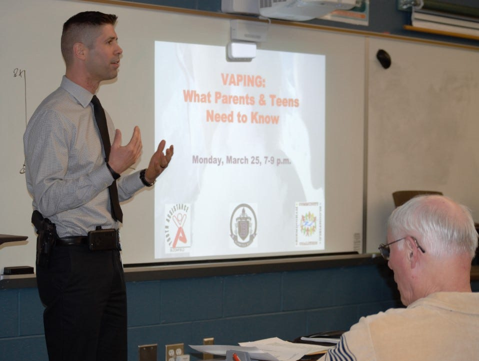 School Liaison Officer David VanKerckhove talks to parents gathered for a vaping event at Bloomfield Hills High School.