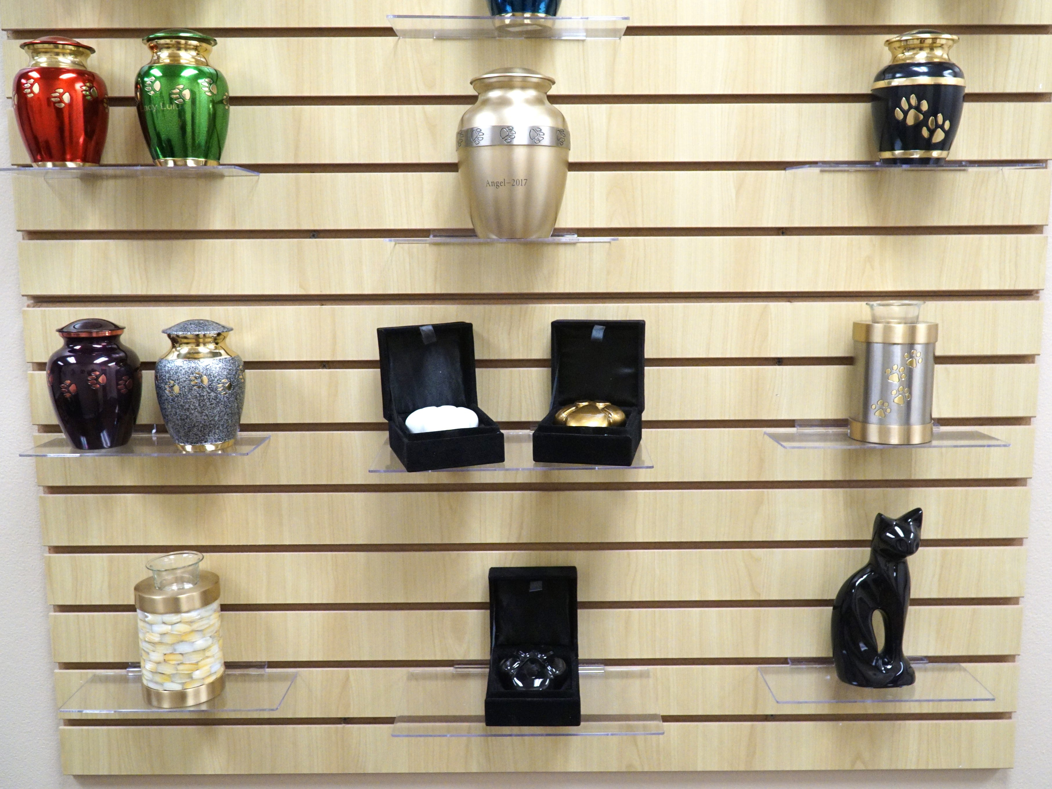 A number of pet cremation urns on display at Livonia's Pet Passages business.