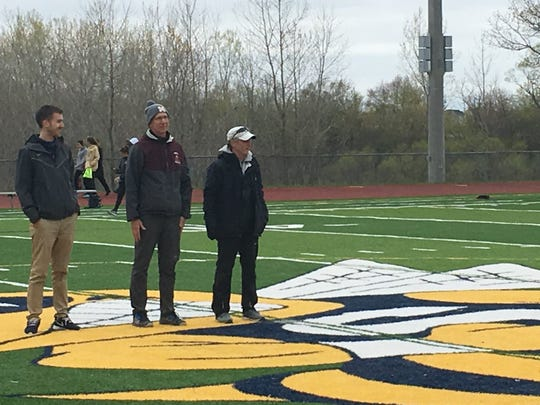 Northville track assistant coach Tom Brown (right) was honored as the Golden Triangle Assistant Coach of the Year.