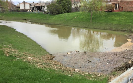 There are steps that can be taken to prevent flooding along this creek that flows through Sunflower subdivision in Canton.