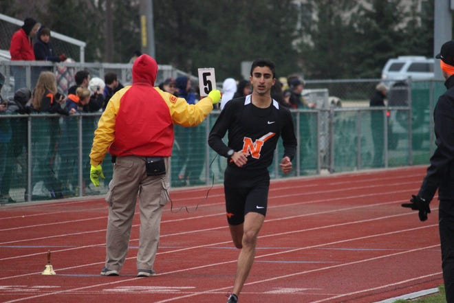 Northville's Nick Couyoumjian set a school record in the 800 last week.