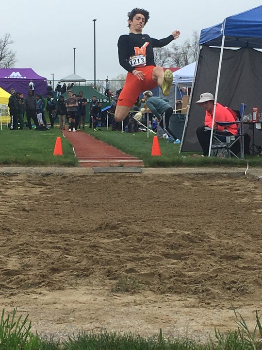 Northville's Demetri Zervos jumps against Novi last week on Senior Day.