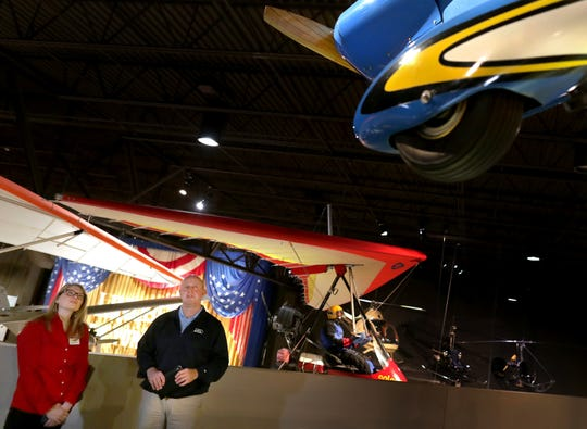 Dick Knapinski, EAA  Director of Communications, gives a museum tour to Wisconsin Deputy Secretary of Tourism Anne Sayersmduring a visit at the EAA Aviation Museum on Monday, May 6, 2019, in Oshkosh, Wis. Wm. Glasheen/USA TODAY NETWORK-Wisconsin.