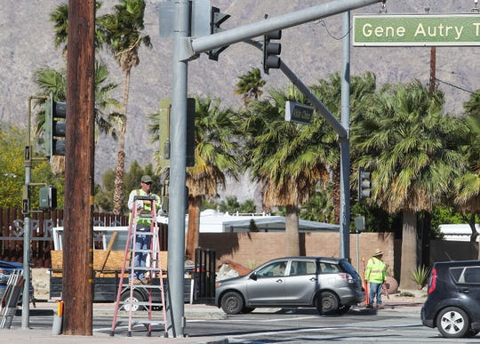 Crews start the process of changing the traffic patterns at the intersection of Gene Autry Trail and Vista Chino where they will create an additional left turn lane from Gene Autry onto Vista Chino in Palm Springs, May 6, 2019.