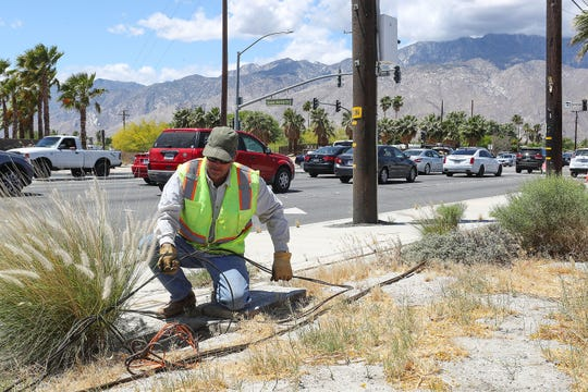 Brian Durocher of Sierra Pacific works at the intersection of Gene Autry Trail and Vista Chino where a second left turn lane is being installed, May 6, 2019.