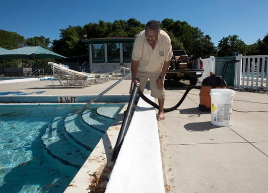 Fred Smiley, a certified pool operator with the city of Pensacola, prepares the swimming pools at the Roger Scott Athletic Complex on Monday for the upcoming summer season. Both city pools, Roger Scott and the Hunter T. Cecil, are scheduled to open to the public on Memorial Day weekend. Admission fees to the Roger Scott Pool are $4 for adults, $3.50 for senior citizens, $3 for children and free for kids under 2. Prices for the Hunter pool are $1 for children ages 3-17, $2.25 for adults and free for kids under 2.