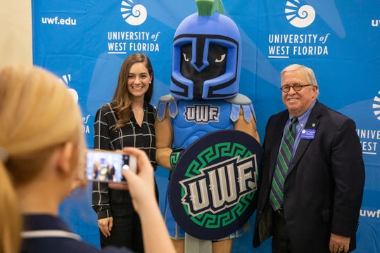 Abigail Megginson and Jerry Maygarden posing with Argie the Argonaut at the Endowed Scholarship Luncheon.