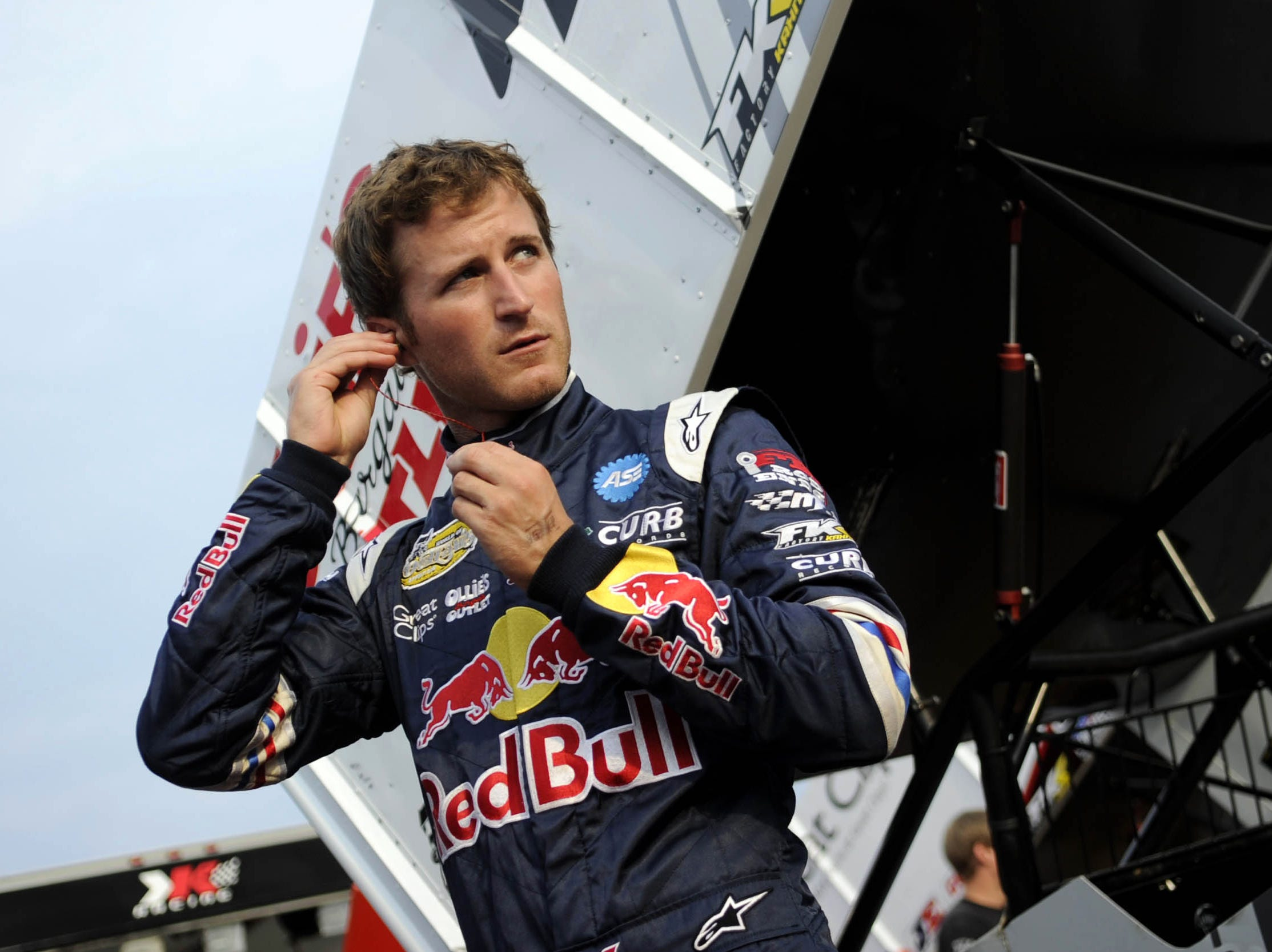 Kasey Kahne puts in his earplugs before time trials at Williams Grove Speedway Friday, July 22, 2011.
