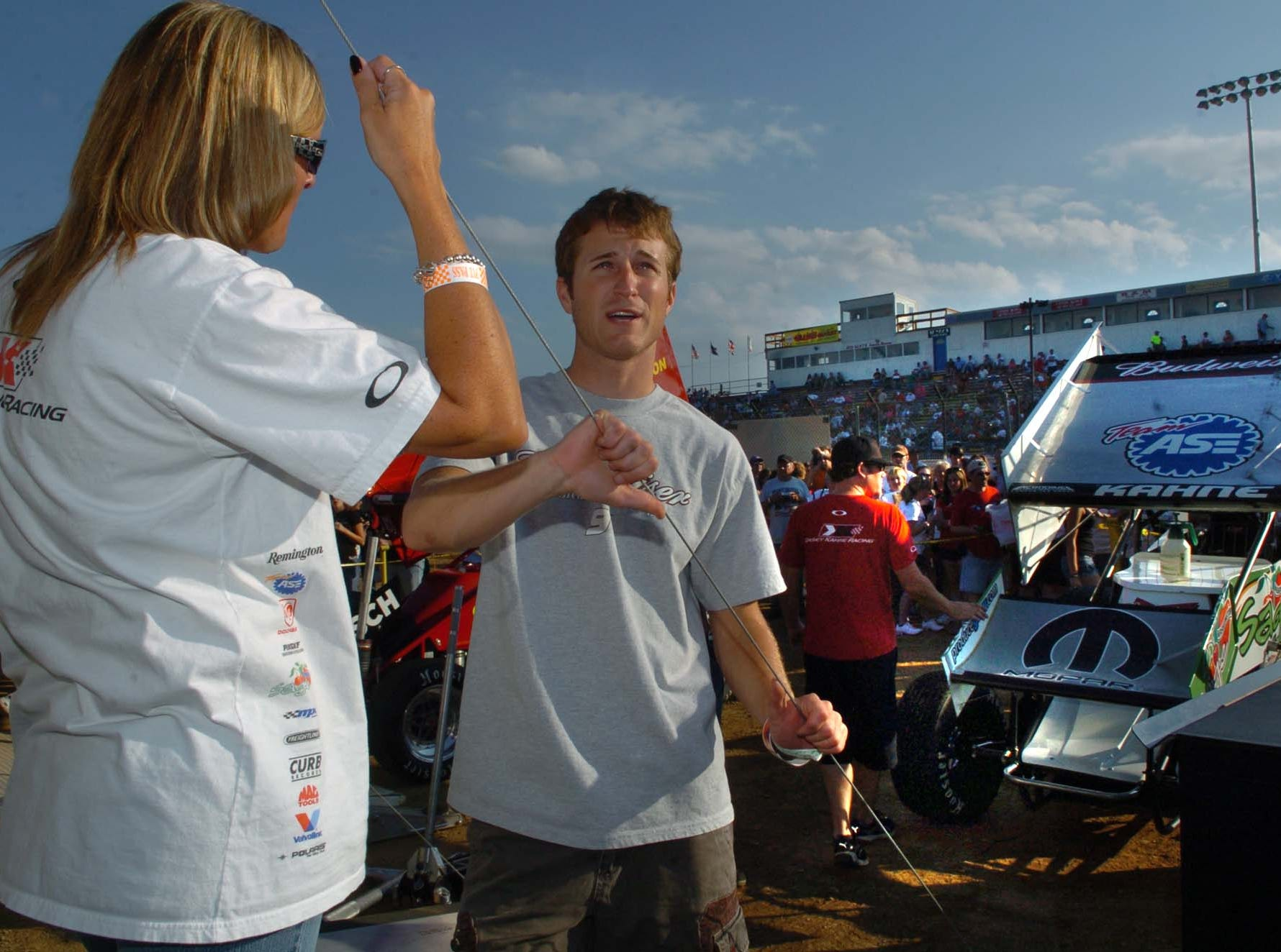 NASCAR Sprint Cup driver Kasey Kahne, center, chats with some of his fans and admirers before action gets under way to Williams Grove Speedway on Tuesday night in Mechanicsburg in 2008.