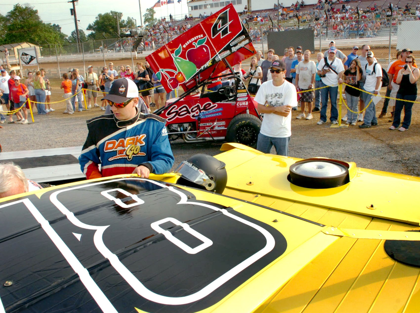 Kyle Busch talks with crew members prior to racing Thursday at Williams Grove in 2010. Busch's car drew a large crowd, as did Kasey Kahne's  No. 4 car behind.